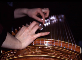 Qin Jun playing the guzheng. Photo by Maggie Holtzberg.